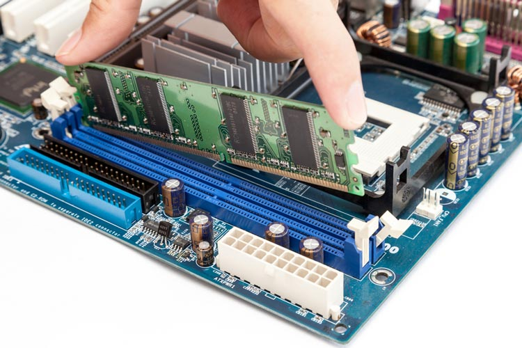 Clip in the new memory modules one end at a time